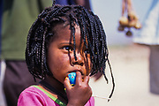 Himba female child in a Himba village, Kaokoveld, Namibia, Africa