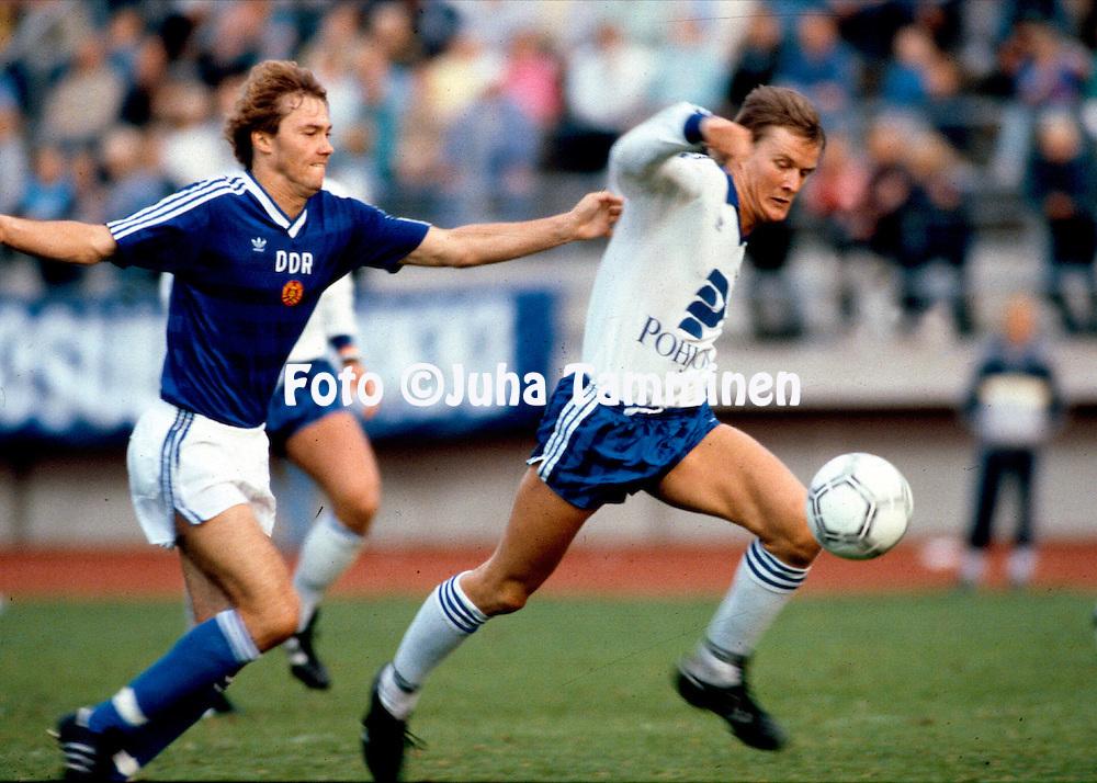 20.8.1986, Urheilukeskus, Lahti, Finland.<br /> Friendly International match, Finland v DDR.<br /> Ari Hjelm runs away from Matthias D&ouml;schner of East German to score the winner for Finland.