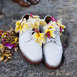 Shoes and flowers at the base of the Duke Paoa Kahanamoku statue, Waikiki
