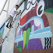 MIAMI, FLORIDA, NOVEMBER 2, 2015<br /> Artists paint the walls of the Wynwood arts district in MIami, Florida two days before the official kickoff of Art Basel 2015. (Photo by Angel Valentin/Freelance)