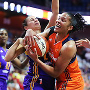 UNCASVILLE, CONNECTICUT- MAY 26:  Alyssa Thomas #25 of the Connecticut Sun pulls in a rebound while challenged by Ana Dabovic #23 of the Los Angeles Sparks during the Los Angeles Sparks Vs Connecticut Sun, WNBA regular season game at Mohegan Sun Arena on May 26, 2016 in Uncasville, Connecticut. (Photo by Tim Clayton/Corbis via Getty Images)