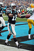 Carolina Panthers wide receiver Damiere Byrd (18) complains to an official about the initial call, which was an incomplete pass later overturned upon review, after catching a 9 yard touchdown pass good for a 24-14 third quarter Panthers lead while covered by Green Bay Packers cornerback Josh Hawkins (28) during the 2017 NFL week 15 regular season football game against the Green Bay Packers, Sunday, Dec. 17, 2017 in Charlotte, N.C. The Panthers won the game 31-24. (©Paul Anthony Spinelli)