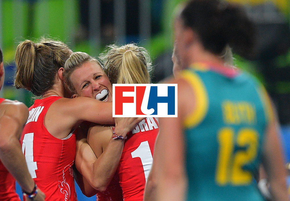 Britain's Alex Danson (C) celebrates scoring a goal during the women's field hockey Britain vs Australia match of the Rio 2016 Olympics Games at the Olympic Hockey Centre in Rio de Janeiro on August, 6 2016. / AFP / Carl DE SOUZA        (Photo credit should read CARL DE SOUZA/AFP/Getty Images)