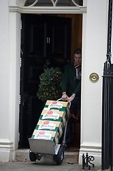 © London News Pictures. 12/12/2012. London, UK.   Pilsner Urquell lager- Trolley number one of five containing alcoholic drinks and glasses being delivered to 11 Downing Street by Majestic wines on December 12, 2012. Photo credit: Ben Cawthra/LNP