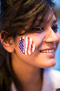 "07 NOVEMBER 2012 - BANGKOK, THAILAND:   A Thai high school student with an ""Election 2012"" sticker on her cheek at the US Embassy's election watch party in Bangkok. US President Barack Obama won a second term Tuesday when he defeated Republican Mitt Romney. Preliminary tallies gave the President more than 300 electoral votes, well over the 270 needed to win. The election in the United States was closely watched in Thailand, which historically has very close ties with the United States. The American Embassy in Bangkok sponsored an election watching event which drew thousands to a downtown Bangkok hotel. American Democrats in Bangkok had their own election watch party at a restaurant in Bangkok.     PHOTO BY JACK KURTZ"