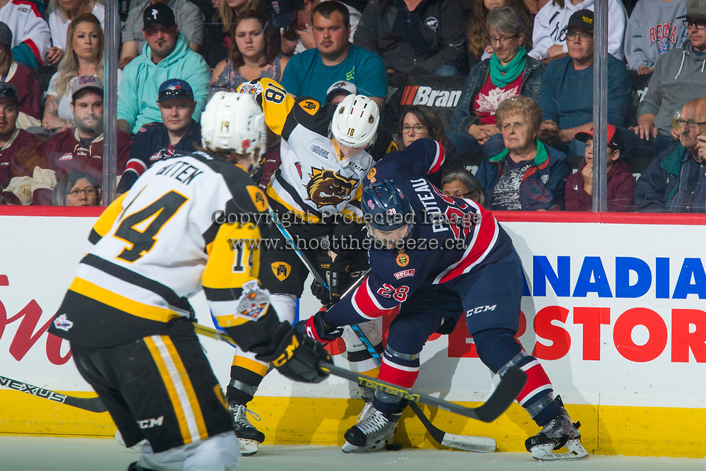 REGINA, SK - MAY 25: Matthew Strome #18 of Hamilton Bulldogs checks Brady Pouteau #28 of Regina Pats at the boards at the Brandt Centre on May 25, 2018 in Regina, Canada. (Photo by Marissa Baecker/CHL Images)