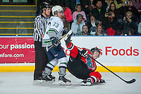 KELOWNA, CANADA - MARCH 18: Mathew Barzal #13 of Seattle Thunderbirds checks Rourke Chartier #14 of Kelowna Rockets to the ice on March 18, 2015 at Prospera Place in Kelowna, British Columbia, Canada.  (Photo by Marissa Baecker/Shoot the Breeze)  *** Local Caption *** Mathew Barzal; Rourke Chartier;