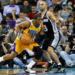 January 22, 2011; New Orleans, LA, USA; New Orleans Hornets point guard Chris Paul (3) drives past San Antonio Spurs point guard Tony Parker (9) during the third quarter at the New Orleans Arena. The Hornets defeated the Spurs 96-72.  Mandatory Credit: Derick E. Hingle