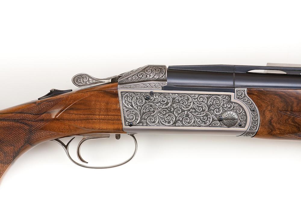 Various high resolution studio shots of shotguns, pistols and rifles.