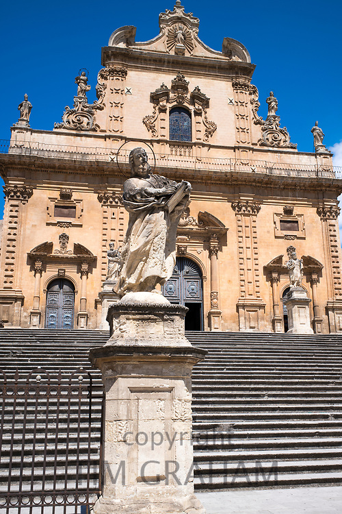 Statue of Saint Peter and front elevation of cathedral church Chiesa di San Pietro Apostolo church in Modica Bassa, Sicily