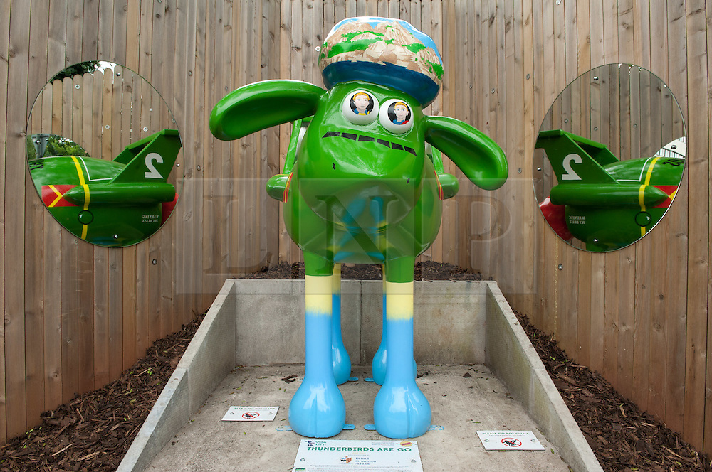 © Licensed to London News Pictures. 06/07/2015. Bristol, UK.  SHAUN THE SHEEP, 'Thunderbirds are Go' designed by Thunderbirds.  The Shaun in the City trail starts today with 70 5ft tall Shaun the Sheep sculptures originally devised by Aardman Animations with these sculptures decorated by various artists.  The Shaun trail happened in London in the spring, and the Bristol Trail lasts till 31 August.  At the end of September all 120 Shaun sculptures will be viewable together in Covent Garden.  All sculptures will then go to auction on 8th October, with proceeds from the Bristol sculptures benefitting The Grand Appeal which funds pioneering medical equipment, facilities, and comforts for patients at Bristol Children's Hospital. Proceeds from the London sculptures will benefit Wallace & Gromit's Children's Charity supporting children's hospitals and hospices throughout the UK. Photo credit : Simon Chapman/LNP