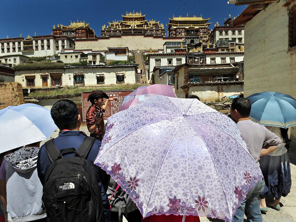 Tour guide at Ganden Sumtsenling Monastery in Shangri-la Yunnan, China; September, 2013.