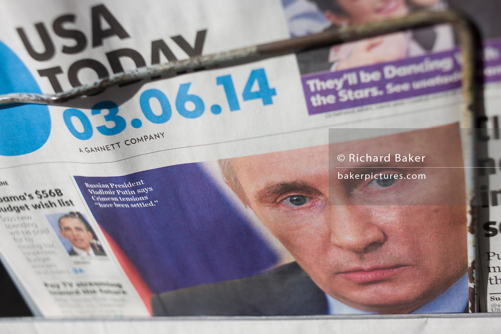 The face of Russian President Vladimirovich Putin appears on the front page of American global newspaper USA Today.