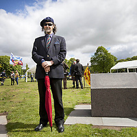 Poet and Guardians trustee, Paraig MacNeil, standing beside the lectern containing an excerpt from his De Moray Epic Poem.<br /> <br /> BRAVEHEART HEROES, WILLIAM WALLACE AND ANDREW DE MORAY, FINALLY HONOURED AT STIRLING BRIDGE BATTLE SITE AS SALTIRE RAISED FOR FIRST TIME IN OVER 700 YEARS<br /> <br /> Friday 29th May, 2015<br /> <br /> IT&rsquo;S TAKEN more than 700 years but today, the two heroes at the centre of one of the most important battles in Scottish history have been jointly honoured at the spot where they both led an outnumbered Scottish army to victory against the English.<br /> The formal unveiling ceremony at Stirling Bridge today (Friday 29th May), of three lecterns made of traditional Scottish whinstone dedicated to the memory of William Wallace and Andrew de Moray,&nbsp;at site of the historic victory at Battle of Stirling Bridge.<br /> At a special ceremony attended by Andrew de Moray&rsquo;s direct descendant, the Earl of Moray, and Stewart Maxwell, MSP, convener of the Scottish Parliament&rsquo;s Education and Culture Committee, the memorials were formally unveiled.Mr Maxwell opened the event and after the dedication, together with the Earl of Moray, they raised the Saltire together at the site of the Battle of Stirling Bridge. This is the first time in over 700 years that the Saltire has flown at Stirling Bridge. The flag will now become a permanent fixture at the site of the Battle.<br /> John Stuart, the current Earl of Moray, said of his illustrious kinsman: &ldquo;I am delighted that Andrew de Moray is finally, after 700 years, to have the recognition he deserves. The Guardians of Scotland have put a huge amount of time and effort into the lecterns, which are a very fitting tribute to one of Scotland's greatest patriots.&quot;<br /> The victory represented a key moment in the Scottish Wars of Independence. Eminent Scots historian, Sir Tom Devine, recently described the battle as being &lsquo;second in importance only to Bannockburn in the Wars of Independence&rsquo;.&nbsp;<br /> It is the first time the two men have been given equal prominen