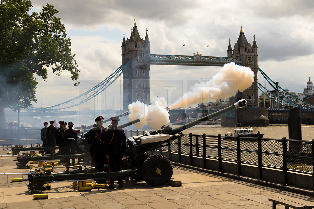 © Licensed to London News Pictures. 03/06/2019. London, UK. The Honourable Artillery Company fire a 103 gun salute at the Tower of London in front of Tower Bridge - 41 guns were fired for the state visit of President of the United States of America, Donald Trump followed by a further 41 guns firing to mark the 66th anniversary of the Coronation of Her Majesty The Queen, followed by 21 guns firing for the City of London. US President, Donald Trump and his wife are on a three-day official visit to the UK. Photo credit: Vickie Flores/LNP