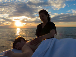 500px Photo ID: 105179511 - Massage therapist working on a client near the water