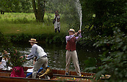 CAMBRIDGE:  Adam Shindler ( blue cravat) spraying champagne The Dangerous Sports Club host the innauguaral Oxford V  Cambridge Punt Race. University Parks. Oxford. 25 June 2005. 25 June 2005. ONE TIME USE ONLY - DO NOT ARCHIVE  © Copyright Photograph by Dafydd Jones 66 Stockwell Park Rd. London SW9 0DA Tel 020 7733 0108 www.dafjones.com
