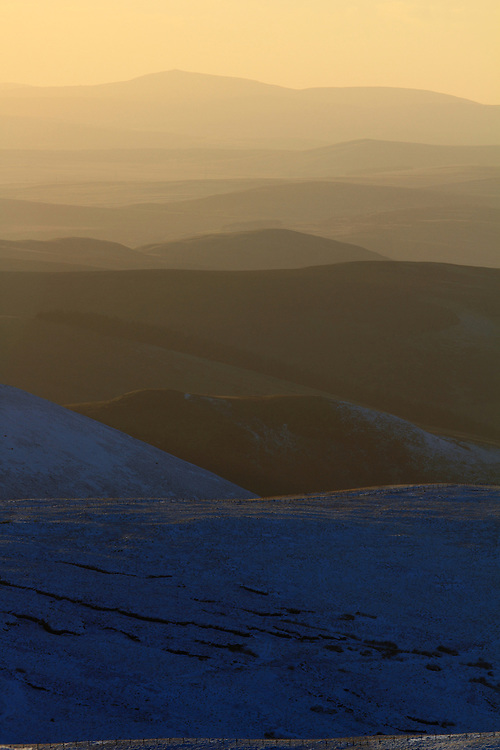 The rolling hills of North Lanarkshire from Chapelgill Hill in the Scottish Borders on an early winter evening