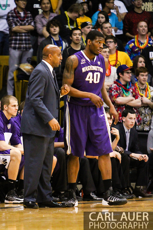 February 9th, 2014:  Washington Huskies head coach Lorenzo Romar talks to junior forward Shawn Kemp, Jr. (40) during a break int he first half action of the NCAA Basketball game between the Washington Huskies and the University of Colorado Buffaloes at the Coors Events Center in Boulder, Colorado