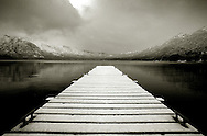 View of a snow covered jetty on Lake Gutierrez, Bariloche, Argentina