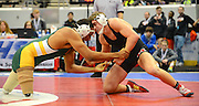 Gary Cosby Jr./Decatur Daily  in the 2015 Wrestling State Championship tournament at the Von Braun Center in Huntsville Thursday.  Muscle Shoals wrestler Braden Barnes faces a unique challenge as he battles Pelham's Hasaan Hawthorne in the 160 pound weight class.