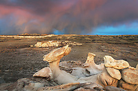 Sunset storm and hoodoos at Bisti Badlands, Bisti/De-Na-Zin Wilderness, New Mexico