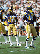 San Diego Chargers wide receiver Wes Chandler (89) and Chargers wide receiver Charlie Joiner (18) rest between plays during the NFL football game AFC Divisional Playoff between the San Diego Chargers and the Miami Dolphins in San Diego California on January 16, 1983. The Dolphins won the game 34-13. ©Paul Anthony Spinelli