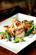 SHOT 8/15/13 5:20:43 PM - Pan Seared Scallops : baby vegetables, fregola, spinach purée, toasted pine nuts, roasted garlic vinaigrette $27. The restaurant, run by chef Justin Brunson, focuses on heritage-raised meats from Colorado farms, features an in-house butchery program and bills itself as contemporary farmhouse cuisine. (Photo by Marc Piscotty / © 2013)