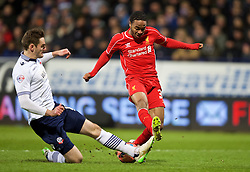 BOLTON, ENGLAND - Wednesday, February 4, 2015: Liverpool's Raheem Sterling is tackled by Bolton Wanderers' Dorian Dervite during the FA Cup 4th Round Replay match at the Reebok Stadium. (Pic by David Rawcliffe/Propaganda)