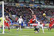 Walsalls Matt Preston (16) and Bolton Wanderers Gary Madine (14) clash in the box during the EFL Sky Bet League 1 match between Bolton Wanderers and Walsall at the Macron Stadium, Bolton, England on 11 February 2017. Photo by Craig Galloway.
