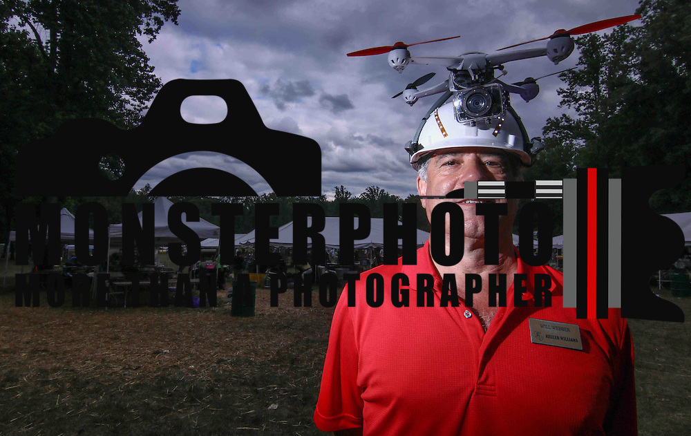 Will Webber a drone user poses for a photograph during The New Castle County Ice Cream Festival Sunday, June 27, 2015, at Rockwood Park in Wilmington, Delaware.