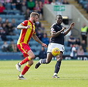 12th May 2018, Dens Park, Dundee, Scotland; Scottish Premier League football, Dundee versus Partick Thistle; Christie Elliott of Partick Thistle and Genseric Kusunga of Dundee
