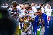 Leeds United defender Pascal Struijk (34) and Leeds United midfielder Mateusz Bogusz (44) celebrates winning the EFL Sky Bet Championship during the EFL Sky Bet Championship match between Leeds United and Charlton Athletic at Elland Road, Leeds, England on 22 July 2020.