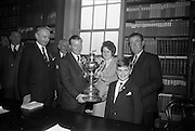 06/05/1965<br /> 05/06/1965<br /> 06 May 1965<br /> Presentation of the Read Cup for quality Butter production at the RDS, Ballsbridge, Dublin. Image shows Mr Charles Haughey, Minister for Agriculture (3rd from left) presenting the Read Cup to Mr Michael O'Leary (right), Manager of the Dairy Disposal Company creamery at Castletownbere, Co. Cork. Also in the picture from left are Mr R.B. Sinnott (Cork) Managing Director of B & I (who presented the cup); Mr John Henigan (Cork), Chairman Dairy Disposal Co.; Miss Maura Harrington, Castletownbere Buttermakers and 13 year old son of Mr O'Leary, Eugene O'Leary.