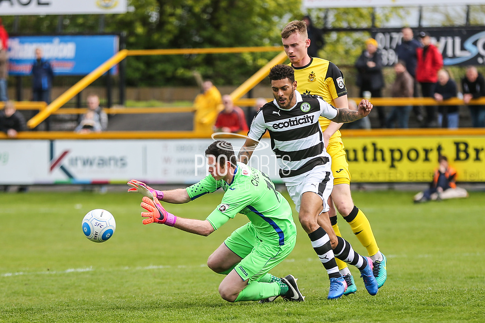 Southport's goalkeeper Chris Cheetham(15) beats Forest Green Rovers Kaiyne Woolery(14) to the ball during the Vanarama National League match between Southport and Forest Green Rovers at the Merseyrail Community Stadium, Southport, United Kingdom on 17 April 2017. Photo by Shane Healey.