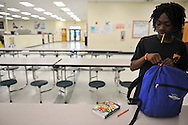 "Antonio Mills, 13, a member of the newly-formed Boy Scout Troop 772 in Fort Pierce, packs up after a troop meeting after school at Dan McCarty Middle School on Feb. 12, 2014. Troop 772 was formed in December 2013 at the school in response to the high levels of gun violence in the northwest part of the city. The ""scoutreach"" troop aimed to give boys attending the school, where many come from neighborhoods with high levels of poverty and crime, an alternative to gang involvement and other pressures faced by their peers. (XAVIER MASCAREÑAS/TREASURE COAST NEWSPAPERS)"