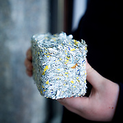 Ireland: Detailed view of a brick made of shredded money at the Billion Euro House art installation by the Irish artist Frank Buckley...Worthless euros, taken out of circulation and shredded by Irelands Central Bank, formes the interior walls of an apartment that Mr. Buckley does not own in a building left vacant by the countrys economic ruin...The artist decided to call the apartment  built from thousands of bricks of shredded, decommissioned cash (each brick contains, roughly, what used to be 50,000 euros)  the Billion Euro House. He reckons that about 1.4 billion euros actually went into it, but the joke, of course, is that it is worth simultaneously so much and so little...A large gravestone beside the main door, announces that Irish sovereignty died in 2010, the year that the government accepted an international bailout so larded with onerous conditions that the Irish will be paying for it for years to come. (Paulo Nunes dos Santos/Polaris)