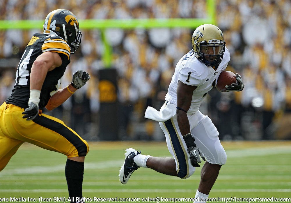 September 17, 2011: Pittsburgh Panthers running back Ray Graham (1) tries to get around Iowa Hawkeyes linebacker James Morris (44) during the first half of the game between the Iowa Hawkeyes and the Pittsburgh Panthers at Kinnick Stadium in Iowa City, Iowa on Saturday, September 17, 2011. Iowa defeated Pittsburgh 31-27.