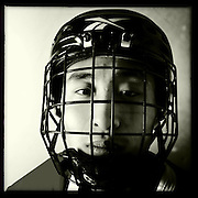 Ice Men Cometh…Zhu Xiaofeng ,19, China..An iPhone portrait series on young men competing in the 2012 IIHF Ice Hockey World Championships Division 3. The tournament  was contested by countries New Zealand, Iceland, China, Bulgaria and Turkey at Dunedin Ice Stadium. Dunedin, Otago, New Zealand. 17th January 2012. Photo Tim Clayton