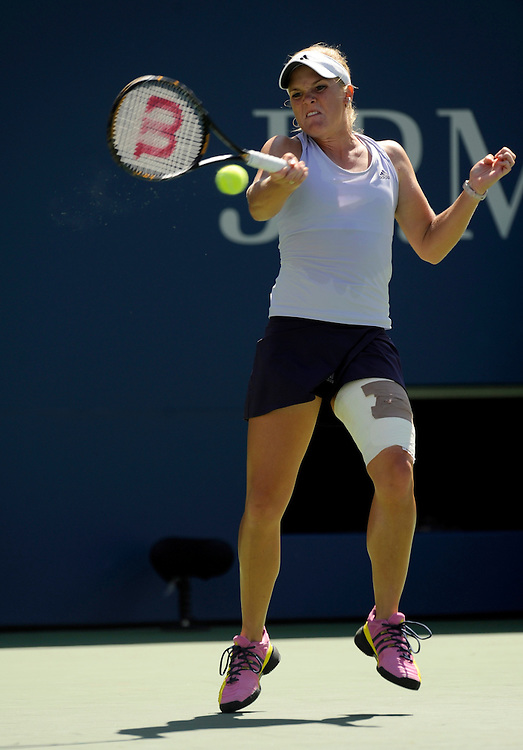 NEW YORK - SEPTEMBER 03: Melanie Oudin returns a ball from  Elena Dementieva during day four of the 2009 U.S. Open at the USTA Billie Jean King National Tennis Center on September 3, 2009 in Flushing neighborhood of the Queens borough of New York City.(Photo by Rob Tringali) *** Local Caption *** Melanie Oudin