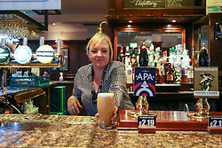 © Licensed to London News Pictures. 04/07/2020. London, UK. A staff member prepares a glass of drink at THE TOLL GATE, a Wetherspoon pub in north London which reopened on Super Saturday. Cafes, restaurants, pubs and hairdressers across the UK closed on 23 March following the coronavirus lockdown. As restrictions are eased, cafes, restaurants, pubs and hairdressers reopens today. Photo credit: Dinendra Haria/LNP