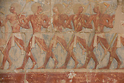 "A detail of ancient Egyptian hieroglyphs showing Somalian slaves at the ancient Egyptian Temple of Hatshepsut near the Valley of the Kings, Luxor, Nile Valley, Egypt. The Mortuary Temple of Queen Hatshepsut, the Djeser-Djeseru, is located beneath cliffs at Deir el Bahari (""the Northern Monastery""). The mortuary temple is dedicated to the sun god Amon-Ra and is considered one of the ""incomparable monuments of ancient Egypt."" The temple was the site of the massacre of 62 people, mostly tourists, by Islamists on 17 November 1997."