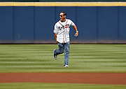 ATLANTA, GA - OCTOBER 2:  Former second baseman Marcus Giles of the Atlanta Braves runs on the field during pre-game ceremonies to honor the last game at Turner Field during the game between the Detroit Tigers and the Atlanta Braves on Sunday, October 2, 2016 in Atlanta, Georgia. (Photo by Mike Zarrilli/MLB Photos via Getty Images) *** Local Caption ***