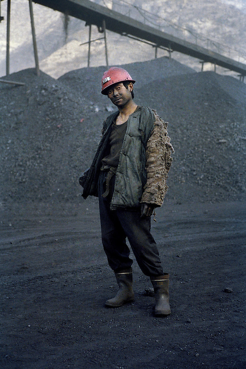 Worker in a small coal mine. China has a total of 28,000 coal mines, 24,000 of them are small ones. Small coal mine are the ones that have the worst safety record. The economy is developing rapidly and does not have enough electricity to power its economic boom. Given this huge need for power and the existence of so many small private coal mines there are huge problems in regulating the industry. Shanxi, China. 2006.