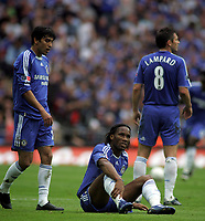 Photo: Paul Thomas.<br /> Chelsea v Manchester United. The FA Cup Final. 19/05/2007.<br /> <br /> Didier Drogba (Ground) of Chelsea isn't happy after being fouled.