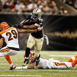Nov 16, 2014; New Orleans, LA, USA; New Orleans Saints running back Mark Ingram (22) runs through a tackle by Cincinnati Bengals cornerback Leon Hall (29) during the first quarter of a game at the Mercedes-Benz Superdome. Mandatory Credit: Derick E. Hingle-USA TODAY Sports