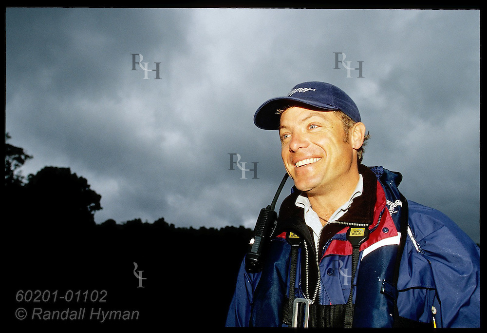 Cruise line expedition leader John Kernan pilots Zodiac in Dusky Sound; Fiordland National Park, New Zealand