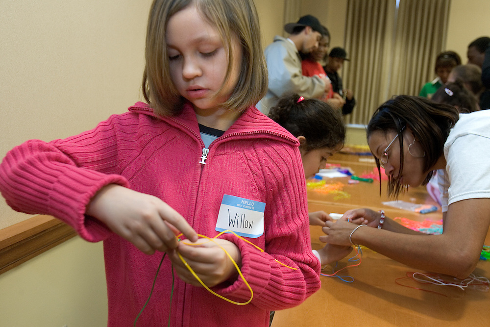 """Willow Krivesti weaves during the """"It Takes a Village"""" program at O.U.'s Multicultural Center on Monday, 1/15/07. The program's goal was to teach tolerance through interactive activities for children."""