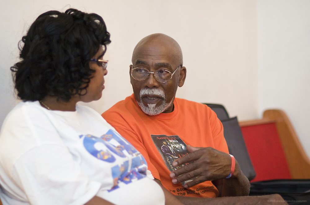 Author Norris Shelton speaks with a member during a book club meeting at the First Church of American Slaves at 314 Dr. W. J. Hodge Street, Saturday Aug. 27, 2011 in Louisville, Ky. (Photo by Brian Bohannon)