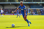 AFC Wimbledon defender Nesta Guinness-Walker (18) about to pass the ball during the EFL Sky Bet League 1 match between AFC Wimbledon and Shrewsbury Town at the Cherry Red Records Stadium, Kingston, England on 14 September 2019.